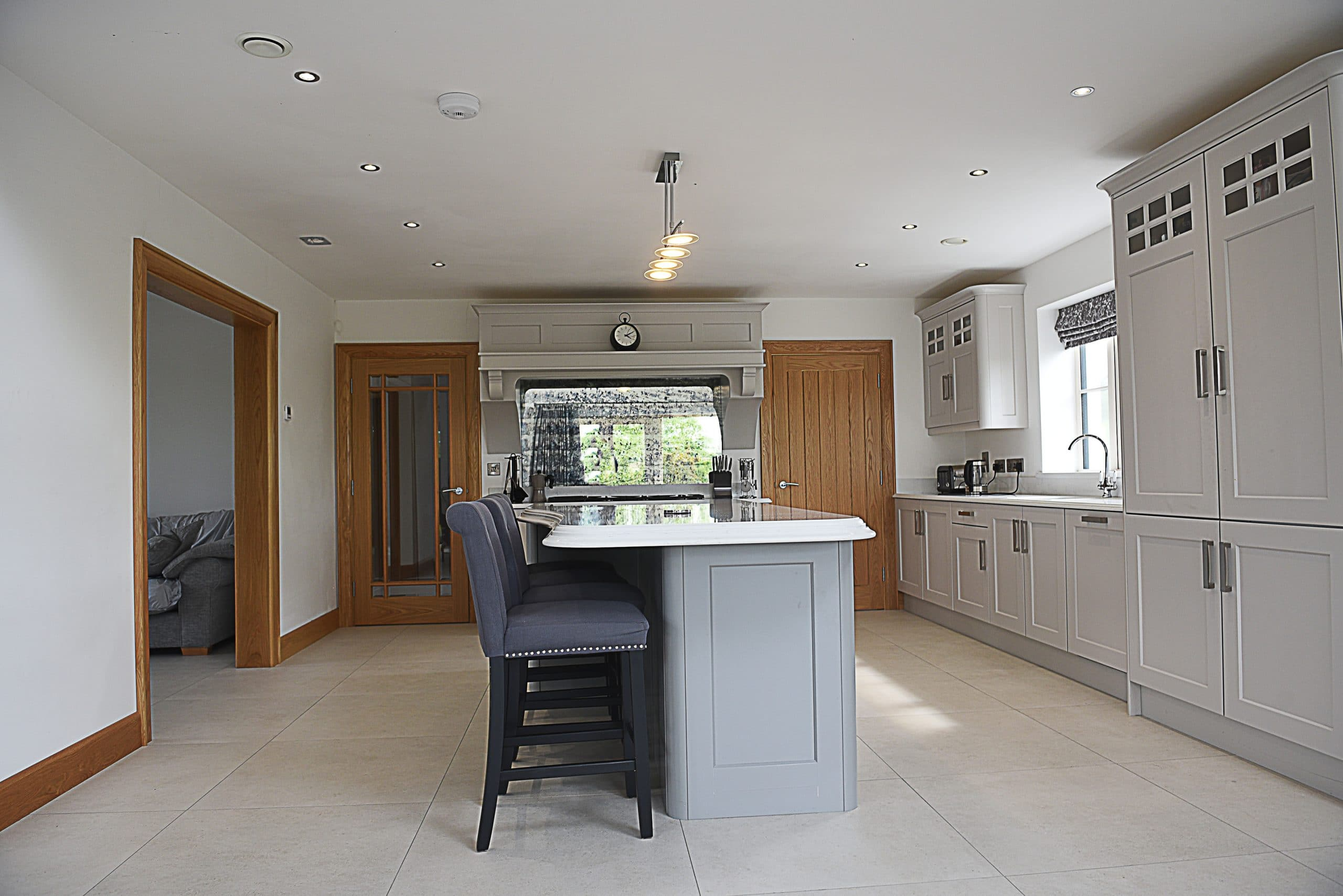 Side view of the shaker kitchen painted Farrow & Ball Purebeck Stone with Plummett island