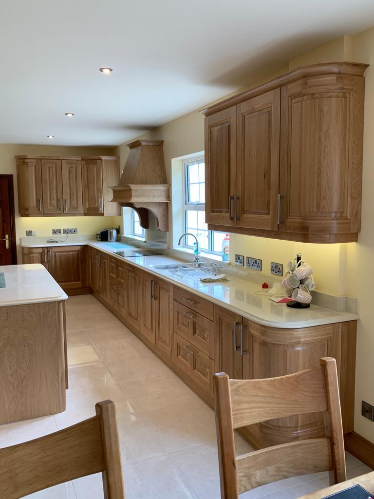 Kitchen overview with curved solid white oak doors